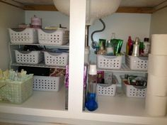 Keep things organized uder sink with the storage baskets. Put similar items together and label these organizers for finding items easily. http://hative.com/creative-under-sink-storage-ideas/