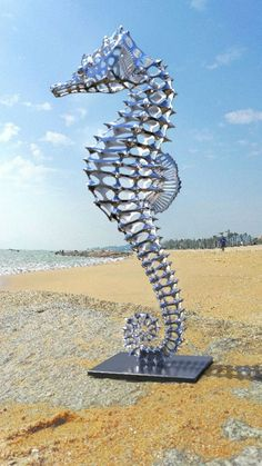 Stainless Steel #sculpture by #sculptor Sebastian Novaky titled: 'Hippocampus (stainless Steel Sea Horse statues)'. #SebastianNovaky