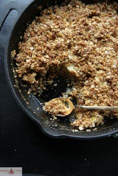 cinnamon caramel apple crisp in a cast iron skillet.