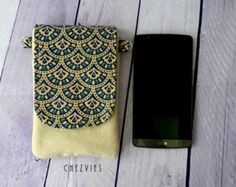 blue iPhone 7 wallet can fit any smartphone size 5 and above. The red iPhone 7 case is made from pure cotton fabric will also fit any android phone. This phone wallet or phone case has front pocket you can use as card holder. This boho cell phone case is perfect as your gadget bag and gadget organizer Made from natural eco friendly dyed block print cotton, its interfaced and padded for protection. Perfect as your gadget bag and gadget organizer.  FEATURES: * Fit most 5 and above smartphone…