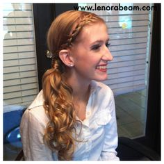 Fabulous prom hair. Side ponytail with braid and lots of curls.