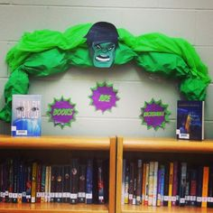 """Hulk-inspired """"Books Are Incredible"""" book nook idea! Print a mask and use a green table cloth and green bulletin board paper stuffed with newspaper for the arms. School Library Displays, Middle School Libraries, Library Themes, Teen Library, Reading Library, Elementary Library, Classroom Displays, Library Ideas, Library Decorations"""