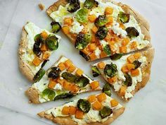 Whole-Wheat Brussels Sprout, Squash and Ricotta Pizza: This colorful pizza is packed with vitamin C, calcium, iron and fiber. We also reduce the amount of cheese (and fat) by dolloping fresh ricotta and sprinkling Parmesan on the pizzas after they're baked.