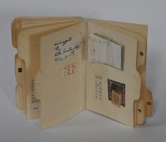 Tabbed index cards, found text, sewing notions, and miscellaneous papers by Bea Hartman.