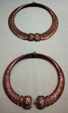 Torcs are metal rings worn around the neck. They often suggest nobility. Torcs were very important to the ancient Celtic culture, and Gods/Goddesses are often depicted wearing them.