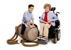 Two children, one in a wheelchair, wearing adaptable clothing.