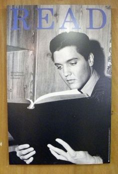 """Elvis READ Poster - For some reason in 1994, ALA managed to resurrect Elvis for the sake of a """"READ"""" poster. It appears to be a book without a title, but he's absorbed in it in a way most celebrities in these posters aren't."""