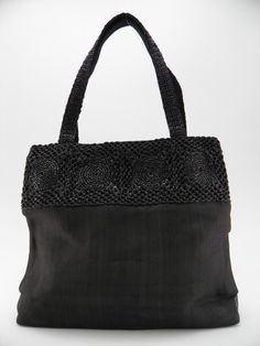 Eco handbag made from recycled plastic bags hand-crocheted mixed with black repurpose fishing net. The Smateria brand. 100% Italian design, 100% Made in Cambodia.