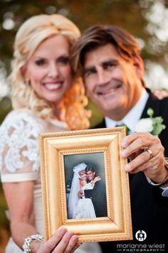 Anniversary Vow Renewal Holding Wedding Photo
