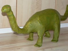 Paper Mache dinosaur. I remember making these with my mom and brother. This isn't mine though (it's a lot nicer).