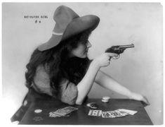 sister gambler brandishing her weapon. Celebrity Art Co., Boston, c. 1912.