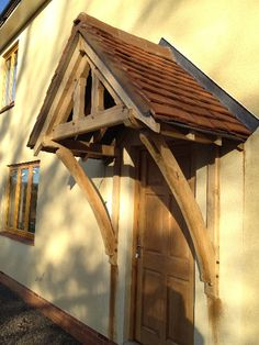 A simple yet attractive way of enhancing your home is a bespoke Oak porch a stunning feature which also offers you a practical addition to your home & Details about Timber Front Door Canopy Porch Bespoke Hand Made ...