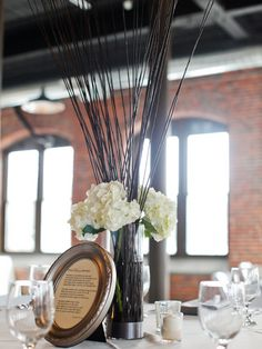 simple rustic centerpiece with vintage framed menu/thank you/seat assignment inserts.