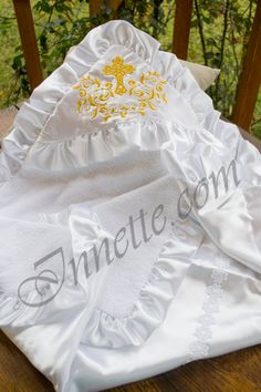 Hooded terrycloth christening towel №12 with golden embroidery. It is a magnificent christening towel of terrycloth on one side and satin fabric on the other. The internal part of a terrycloth christening towel is 100% cotton. There is a satin frill on the towel`s perimeter. On its edge there is a hood with cross-stitch and golden thread of a gentle tracery. The wrong side of a stitch is closed with batiste fabric. Its size is 90cm x 90cm. #christeningtowel #christeningblanket #baptismtowel