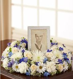 Floral wreaths are a great way to encircle photos of your loved one or their urn during a memorial.