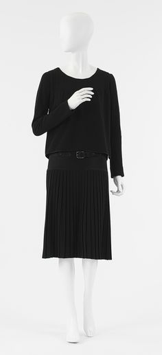 "Chanel's uncluttered styles, with their boxy lines and shortened skirts, allowed women to leave their corsets behind and freed them for the practical activities made necessary by the war. Elements of these early designs became hallmarks of the Chanel look . She was the inventor of ""the little black dress"" that could be dressed up or down by accessories."