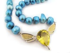 Photo: Bee clasp with citrine in silver and 18ct yellow gold. Commissioned and sold by Veronica Anderson Jewellers.
