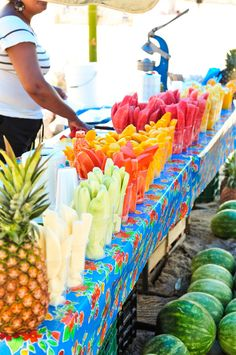 Yummy fresh fruit waiting for you to stop by, grab one and start your morning with a sweet treat...love the blue table cloth  www.casitassayulita.com