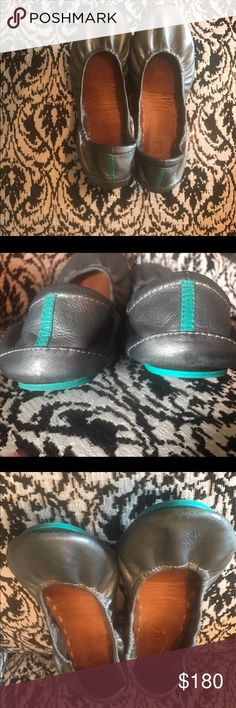 Tieks Metallic Pewter 7 Metallic Pewter Tieks in size 7. Perfectly broken in for you already, so no big toe pain! Normal wear, such as scuff on drivers heel, but nothing a nice polish paint couldn't fix to make like new again! Insoles are normal darken from wear, but NO smell! These retail $195 plus tax. I tried to photograph the worse of the wear, but you really can't tell when wearing. These are beautiful! I'm a 6.5, and I feel like they are too big for me now that they've been broken in…