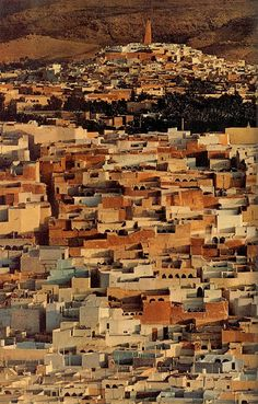 "July 1972 ""Lighthouse for the faithful, the minaret at Ghardaia rises above a cluster of five Algerian towns where Islam survives little changed in a thousand years.""