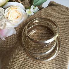 """Five bangles gold finish These bangles are well made and have some weight to them. Two have hammered finish. 2 1/2"""" opening. Jewelry Bracelets"""