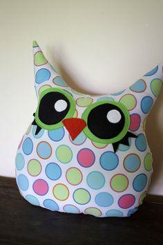 An owl plush polka-dot pillow is cuddly cute!