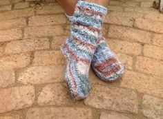 Dan's slipper socks...super cosy with soles and cables. Size 9