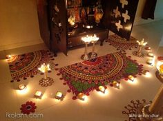 Colorful rangolis near mandir / pooja room Rangoli Designs Flower, Rangoli Ideas, Rangoli Designs Diwali, Flower Rangoli, Beautiful Rangoli Designs, Diwali Decorations At Home, Festival Decorations, Flower Decorations, Diwali Diy