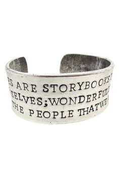 """Our lives are storybooks we write for ourselves; wonderfully illustrated by the people we meet"" cuff"