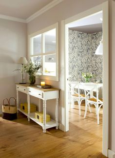 The ground, if not white, make it clear - entrance hall with white console and open window to the dining room 00470787 -