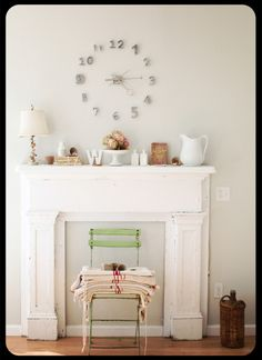 The mantle remains uncluttered-feeling because of all the whites. #mantle #white