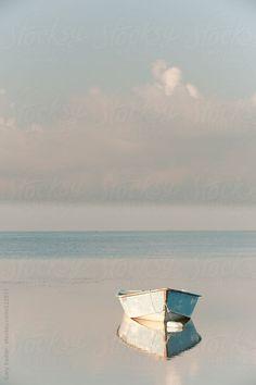 Row Boat reflected in Still Water by Gary Radler