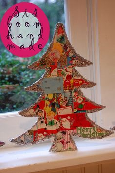 SisBoom Blog-Quick Craft-take a flat tree, glue on vintage tree tags or Christmas cards, outline the edges with glue and glitter, use a block or spool glued to the back to stand it up