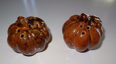 Ceramic pumpkin salt and pepper shakers. Brown color.
