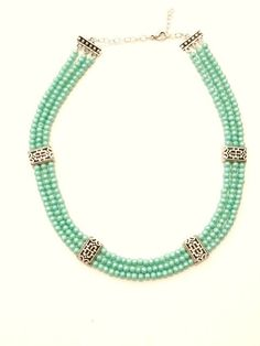 Light Green/Aqua Textured Pearly 3 Strand Necklace with Repeating Silver Plated Design Detail
