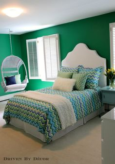 Tween bedroom makeover with bold green walls, DIY headboard and bedskirt, and hanging swing chair.