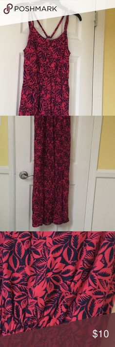 Maxi Dress Used but worn only a few times. Comfortable, lightweight maxi dress with a pretty bright hawaian flower pattern. Although its a size medium, could still pass for a small if you are  taller. Tiny white stain on the back ( might be a bleach stain or just a production material defect). Charlotte Russe Dresses Maxi
