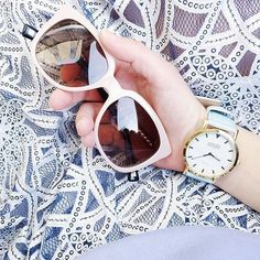 For those brighter days ahead. White sunglasses and a chic watch.
