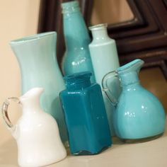 Turn clear glass into pretty color glass....just use acrylic paint, swirl around and let dry overnight!