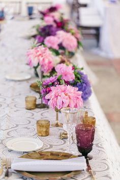 Chic pink and purple florals with a lace table runner.