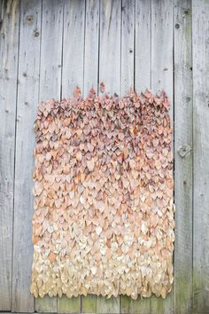 fall leaf DIY backrop - photo by Tom and Keidi Photography http://ruffledblog.com/best-of-2014-diy #diyproject #weddingdiy #backdrops