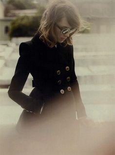 so many things to like . . her hair, glasses, pea coat, the style of the photograph