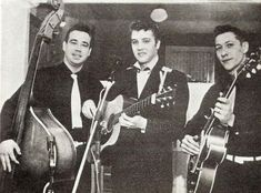 Let´s Keep the 50´s Spirit Alive!: July 12, 1955 - Elvis, together with his parents, signed a one year contract making Scotty Moore his manager. Photo shows Bill Black, Elvis and Scotty Moore in 1954