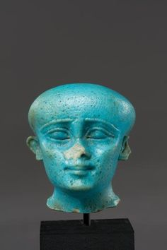 Egyptian Bright Blue Glazed Faience Head of Ptaichos | 6th Century BC | Price $17,200.00 | Egyptian | Faience | Amulets, Sculpture | eTiquities by Phoenix Ancient Art