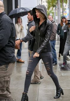 Staying dry: Taylor Swift wore a hooded black leather biker jacket while heading to the Saint Laurent Paris store in Beverly Hills on Thursday