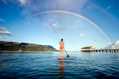 A woman on a stand up paddle board in Hanalei Bay - M Swiet/Getty Images Kauai voted #1 Winter Getaway Again!! US News & World Report