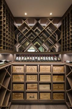 A beautifully well organised wine cellar using racks and old wine boxes