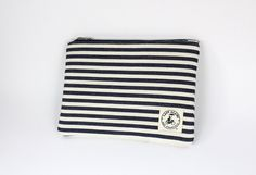 Makeup Bag In Nautical Navy Stripes. $24.00, via Etsy.