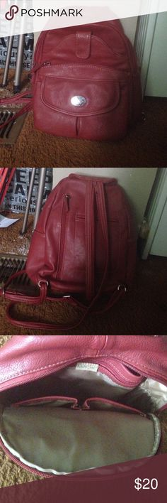 Red Backpack Has many pockets - 10 including the big pocket. Fits a lot of stuff!! Has been used a lot but is in a very good condition. All zippers still work. Has two straps in back. Material is fake leather MultiSac Bags Backpacks