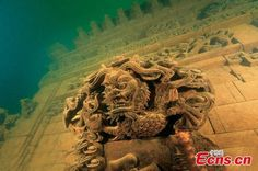 """Lion City, a thousand-year-old ancient city, is buried under Qiandao Lake, Zhejiang province. It vanished in 1959 to make way for a new hydroelectric power station. Protected from wind, rain, and sun, the entire city has been branded a """"time capsule"""" as almost every structure remains completely intact, including wooden beams and stairs."""